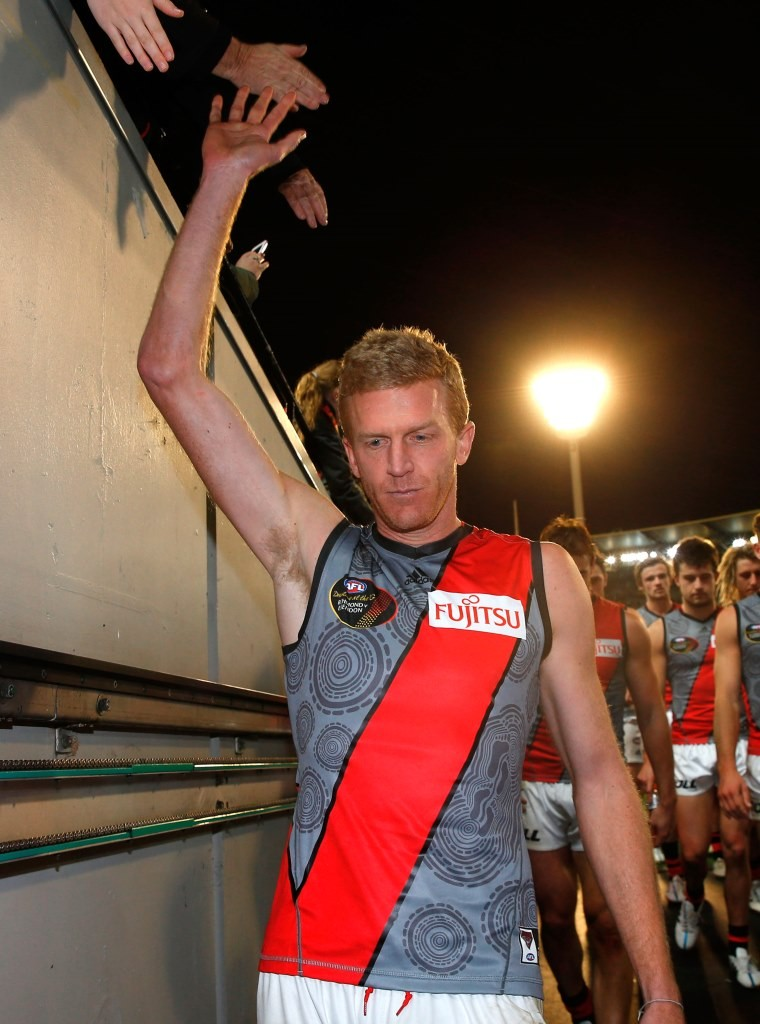 Dustin Fletcher of the Bombers leaves the field after his 400th match during the 2015 AFL Round 09 Dreamtime at the G match between Richmond Tigers and the Essendon Bombers at the MCG, Melbourne on May 30, 2015. (Photo: Michael Willson/AFL Media)
